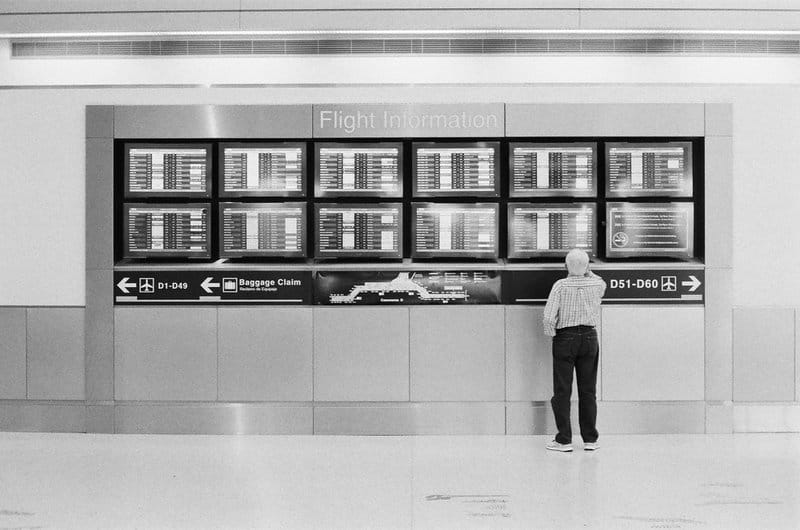 man looking at the flight information